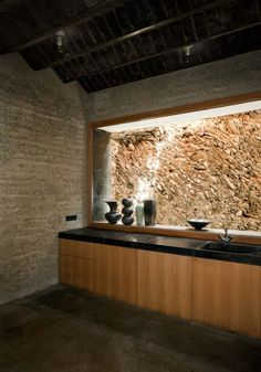 Martin Rauch's house, designed in conjunction with Roger Bolthauser in Schlins, completed in 2008. Embedded in the narrow hillside plot, all of the house's materials, from the rammed-earth exterior walls, the aggregate for the smooth poured concrete interiors, to the custom clay floor tiles, are made from soil based materials.