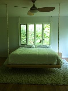 wooden bed hanging by roof