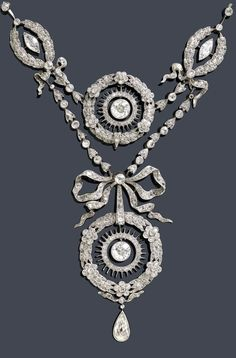 A Belle Epoque platinum and diamond necklace, circa 1900. Designed as floral and foliate garlands, the largest garland surmounted by a bow motif, set throughout with rose-cut diamonds, and suspending a pear-shaped diamond, mounted in platinum. #antique #BelleEpoque #necklace