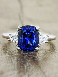 Blue sapphire engagement ring with trapezoid side diamonds by Ken & Dana Design.