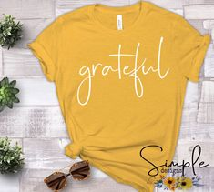 Grateful T-shirt Sale Bella Canvas Tees – Simple Designs and More The perfect t-shirt to go under those cute flannels, paired with jeans and boots! Don't miss this sale Bella T Shirts, Autumn T Shirts, Vinyl Shirts, Christian Clothing, Bella Canvas, Tshirt Colors, Jeans And Boots, Shirt Style, Shirt Designs