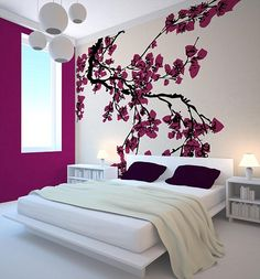 Plum & White: This is an artful use of plum and white - the beautiful painted blossoms also double as a headboard so the bed frame, side tables and lamps are very minimalistic. The dark pillows tie in nicely with the branches and ground this very airy room. modern Japanese bedroom with cherry blossom decoration