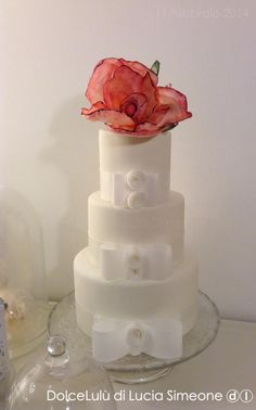 """Simple Elegance"" ~ wafer Peony  and wafer Bows  on a super clean fondant wedding cake  ~  all edible"