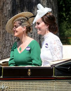 Like the Queen, Sophie Wessex was resplendent in green, wearing a pendant necklace to match her outfit