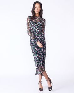 258c0588f48b Tatum Dress by Veronica Beard  Feminine details and a vibrant floral print  elevate our Tatum Dress. Tailored in silk with a built-in camisole