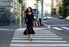 Womenswear Street Style. Chiara Totire wearing a black deconstructed midi dress on the street. Photography by Ángel Robles. Fashion Photography from Milan Fashion Week.