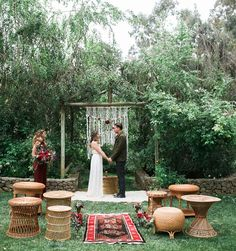 boho macrame ceremony inspiration - red aisle rug - woven basket chairs for guest seating.