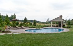 Custom Pool set far away from the house, becomes a focal point beyond the lush lawn.