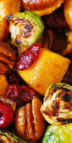 Thanksgiving Side Dish: Roasted Brussels Sprouts, Cinnamon Butternut Squash, Pecans, and Cranberries (and maple syrup). YUM!