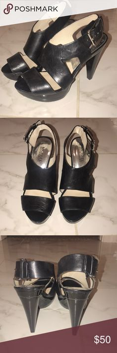 Black Michael Kors Heels black heels with silver buckles and a small stain on the inside KORS Michael Kors Shoes Heels