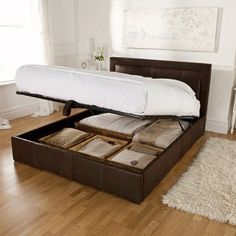 bed with storage. This is so perfect for our room it's not even funny. I wish John wasn't such a pack rat!