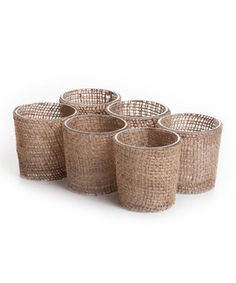 Add rustic style to any gathering with this charming set. Featuring sturdy burlap wrapped over glass, it's a charming display for flickering flames.