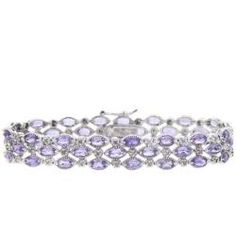 @Overstock - Three rows of vibrant oval-cut amethysts and two sparkling white diamond accents adorn this attractive bracelet. The bracelet is crafted of highly polished sterling silver and secures with a hidden clasp and safety.http://www.overstock.com/Jewelry-Watches/Sterling-Silver-Amethyst-and-Diamond-Accent-3-row-Bracelet/4999128/product.html?CID=214117 $56.99