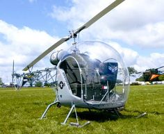 """A nice looking Safari """"Baby Bell"""" on the grass at AirVenture 2010."""
