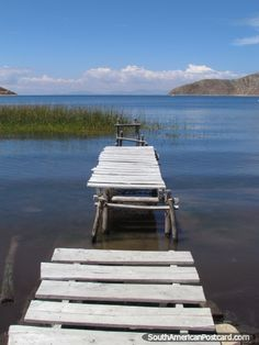 Broken jetty and lake reeds at Isla del Sol, Lake Titicaca. Photo from Bolivia. See photos from South America. Bolivia, Taking Pictures, Cool Pictures, South American Countries, Lake Titicaca, Grey Skies, Florida Usa, Photography For Beginners, Nature Scenes