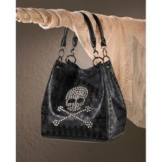"Carrying this cool black tote will add some rock-n-roll attitude to your outfit. The bag features a crystalline skull and cross bones on top of the black-on-black skull pattern, edged with stud detailing.  Item weight: 2.40lbs Item dimensions: 10.00"" W x 20.50"" H x 11.50"" L Materials: Polyuret..."