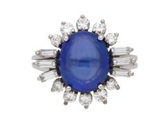 Vintage cabochon sapphire and diamond cluster ring, circa 1960.