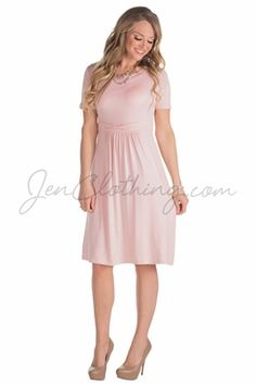 """Simply stylish, with a cute bow detail at the waist. Flattering fit, especially with the gathering at the waist to help hide imperfections! Available in a variety of colors, and it's perfect for everything from date night or Sunday meetings to a modest bridesmaid dress your girlfriends will love you for--because they'll wear it again & again, not just on the big day! """"Erin"""" Modest Dress in Lotus Light Blush Pink"""