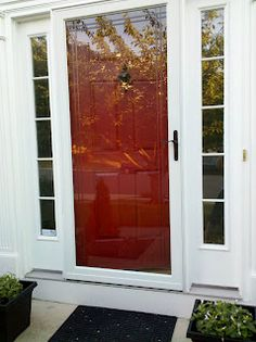 Black storm door with red door. (I have a black door that gets too ...