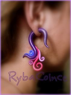 love these fake gauge earrings.  :-)  made with polymer clay and silver posts.  Choose your colors.