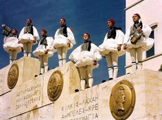 Evzones Stand at Attention on Stairway Wall, a Soldier Blows Trumpet Photographic Print byPhotographer: B. Mykonos, Zorba The Greek, Stairway Walls, Standing At Attention, In Ancient Times, Animal Party, Ancient Greece, Greece Travel, Crete