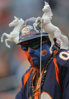 Mounted on the shoulders!  My dad the Bronco Fan!