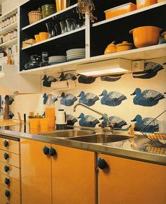 Cool retro kitchen with great colour and shelving..  not taking itself too seriously