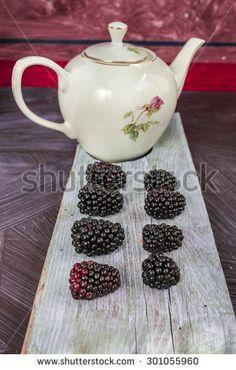 Blackberry and white teapot - stock photo