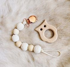 Rose Collection-- Featuring our newest additions, beautiful Rose Gold Pacifier/Teething Clips! Cute and functional! Keeping babys pacifier or toy from falling to the ground and in arms reach. Each clip comes with 3 wooden teething beads made from 100% Organic Maple Wood, and 4