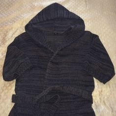 Gray Hooded Wrap Sweater Half Sleeves Great for spring, especially for us in the North! Great condition, no tears, holes or stains. Half sleeves are nice if you like lots of bracelets. Perfect with a white tank and leggings/skinny jeans and your favorite pumps or heels! No string in the hood. New York & Company Sweaters
