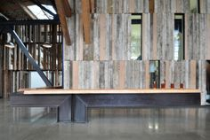 Reclaimed wood from an old mill was used to create this fantastic paneling at a distillery in Seattle.