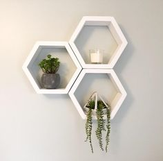 floating shelves This listing is for 3 of our medium sized white honeycomb shelves. These unique shelves are handmade using the best quality wood. These can be arranged together or se Geometric Shelves, Honeycomb Shelves, Hexagon Shelves, Geometric Decor, White Shelves, Wooden Shelves, White Floating Shelves, Decorating With Floating Shelves, Shelves On Wall