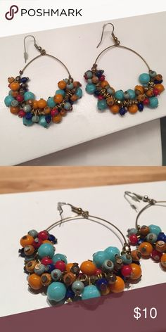 Multicolor Beaded Earrings Dress up a basic tee or LBD with these fun and eclectic beaded earrings. Gold metal detailing and fixtures with plastic and painted wood beads. Nordstrom Jewelry Earrings