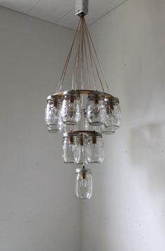 3 tier Mason Jar Chandelier - Mason Jar Lighting - Upside Down Wedding Cake - Handcrafted Upcycled BootsNGus Hanging Pendant Light Fixture. $325.00, via Etsy.