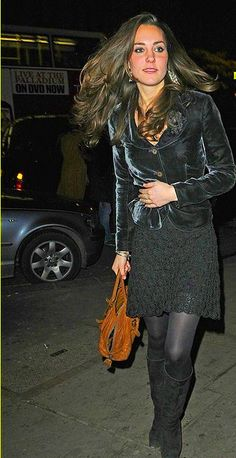 Black velvet jacket, black lace dress, black tights, black suede boots, and spectacular hair