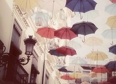 would love to have a ceiling covered with umbrellas
