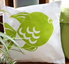 CUSHION cover, with green fish hand printed.
