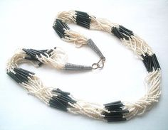 Hey, I found this really awesome Etsy listing at https://www.etsy.com/listing/121086553/vintage-multi-strand-glass-seed-bead