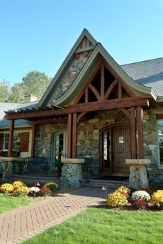 Finely Crafted English Cottage | Hendel Homes- Like the stone front of this and wood beam details.