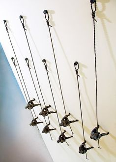An ordinary wall becomes a focal point with the addition of Global Views' Climbing Man wall-mounted art.