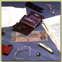 Items carried in Lincoln's pockets on the night of his assassination at Ford's Theatre.