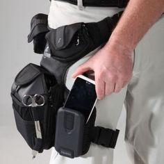 Specially designed cell phone / electronics pouch with protective RigidLite shell that fits and protects all smartphones on the market. Lifeguard Costume, Tactical Medic, Emergency Response Team, Training Kit, Mens Toys, Athletic Trainer, Chest Rig, Tac Gear, Sports Medicine