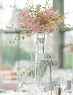 Wedding decor is incomplete without centrepieces. So here you go for some ideas to decorate with tall vases: Blossoms with Floating Candles Image via: Wedding Table Centerpieces, Floral Centerpieces, Reception Decorations, Floral Arrangements, Christmas Centerpieces, Centerpiece Ideas, Mod Wedding, Dream Wedding, Wedding Reception