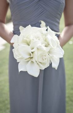 all white callas & roses bouquet. I like this for the bridal bouquet with bling accents and a ribbon the same color as bridesmaid bouquets
