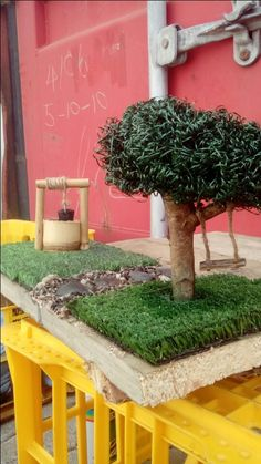 Miniature garden. Steel wool trees, bamboo well, turf lawn and pepple path