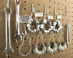 Hang up shower curtain rings  Old-fashioned shower curtain rings   can organize and conveniently display nuts and washers on your pegboard. Load up the rings, add a tape label, and hang them near the wrenches. You can also toss them in a nail apron for on-the-go repairs.
