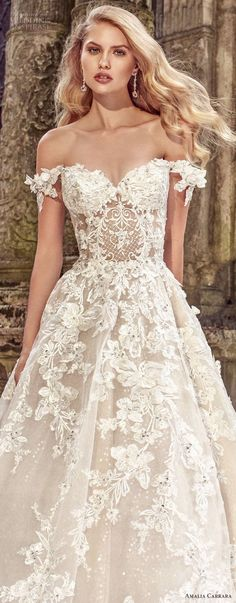 The lace on this beautifully designed wedding gown makes it so romantic. #weddingdresses