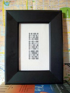 I Love You binary cross stitches to custom order, red or black, mounted or framed. $12.00, via Etsy.