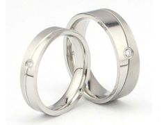 His & Hers Matching Set 6MM / 4MM Titanium Couple Wedding Band Set (Available Sizes 6MM 7 to 10 & 4MM 5 to 8)... $19.99