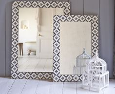 The beautiful Banyan bone mirror has a gorgeous black and white geometric border. It comes in two sizes.